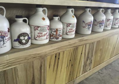 syrup jugs many labels