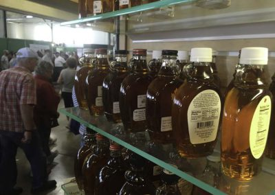 visitors passing syrup shelf